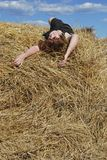 Hay. The beautiful woman is relax on the hay Stock Images