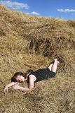 Hay. The young woman is relax on the hay Stock Image