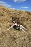 Hay. The young woman is relax on the hay Royalty Free Stock Photo