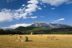 Hay bails with sweeping views of Parque National de Ordesa near Ainsa, Huesca, Spain in Pyrenees Mountains Royalty Free Stock Photos