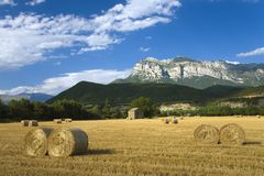 Hay bails with sweeping views of Parque National de Ordesa near Ainsa, Huesca, Spain in Pyrenees Mountains Royalty Free Stock Photography