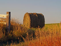 Hay Bale And Fence Post Stock Photography