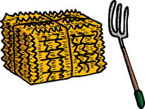 Hay Bale And Pitchfork Stock Photo