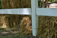 Hay bale behind fence Stock Images