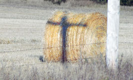 Hay bale with cross. Hay bale with shadow of cross Stock Images