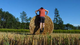Hay bale exercises stock footage