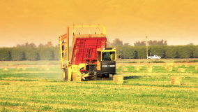 Hay Bale Machine Loader on Farm stock footage