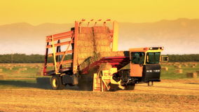 Hay Bale Machine Loader on Farm stock video