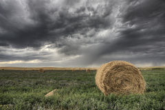Hay Bale and Prairie Storm Stock Image