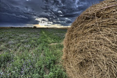 Hay Bale and Prairie Storm Stock Photo