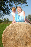 Hay bale. Two happy children sitting on a hay bale Stock Photos