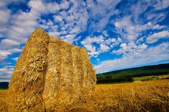 Hay bale under a big blue sky Stock Image