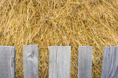 Hay bale with a wooden fence Stock Photo