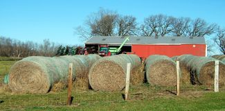 Hay-Baled and Ready. Hay bales in a feed lot in Iowa. Hay is a big part of the ag. sceen in Madison County, IA stock images