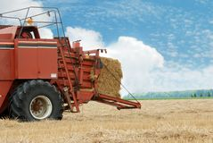 Hay baler in the field Stock Photos