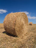 Hay bales. Two hay bales in front of a blue sky with clouds Royalty Free Stock Photography