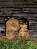 Hay bales in barn Stock Photo
