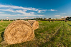 Hay Bales Below Blue Sky Fotos de Stock