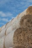 Hay bales and cloudy sky Royalty Free Stock Photography