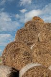 Hay bales and cloudy sky Royalty Free Stock Photo