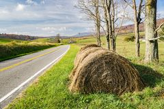 Hay Bales by a County Road. Hay bales by a country road in Sinking Creek Valley below Johns Creek Mountain located in Jefferson National Forest, Giles County stock photo