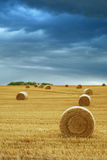 Hay Bales in Field Stormy Sky Royalty Free Stock Photo
