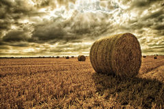 Hay Bales In Field Under An Angry Sky 2 stock photos