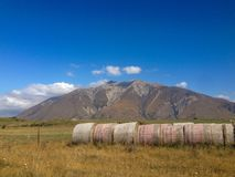 Hay bales in front of mountains on the South Island of New Zealand stock images