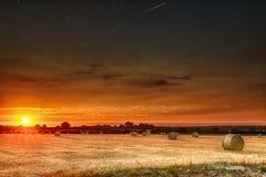 Hay bales at sunset and stars royalty free stock photo