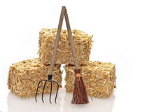 Hay bales with tools. On a white background Royalty Free Stock Photo
