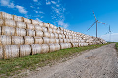 Hay bales and windmills Royalty Free Stock Images