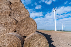 Hay bales and windmills Royalty Free Stock Photography
