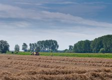 Hay baling in the Netherlands Royalty Free Stock Image