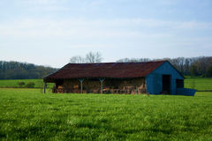 Hay Barn. A hay barn sitting in a green field stock photos