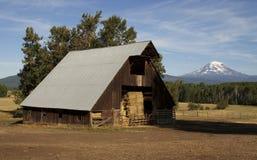 Hay Barn Ranch Countryside Mount Adams Mountain Farmland Landsca. Mt Adams looms over lush ranch land in Washington state Stock Images