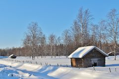 Hay barns in winter landscape Royalty Free Stock Images