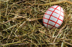 Hay and easter eggs Stock Photography