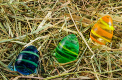 Hay and easter eggs Stock Photos