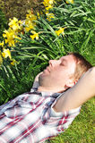 Hay fever. Young man allergic to pollen and spring flowers Stock Photo