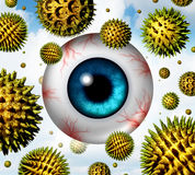 Hay Fever. And pollen allergy concept as a group of microscopic organic pollination particles flying in the air with an itchy and watery human eye ball with red Stock Image