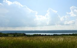 Hay field overlooking Seneca Lake the largest Finger Lake. Seneca Lake is the largest of the glacial Finger Lakes of the U.S. state of New York, and the deepest stock photos
