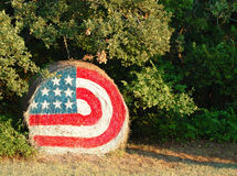 Hay flag. A bale of hay with a flag painted on it Stock Images