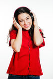 Hay girl with headphones Stock Images