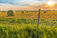 Hay harvest. North Dakota sunset just off Route 83 north of Bismarck Royalty Free Stock Photos