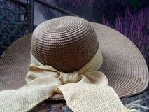 Hay hat and beautiful ribbin in flower garden Stock Photo