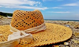 Hay hat on the sand in a beautiful sunny day. Hay hat lying on the sand in a beautiful sunny day Royalty Free Stock Photography