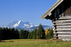 Hay hut in front of Zugspitze Stock Photo