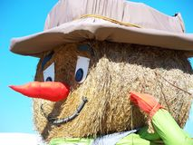 Hay Man. A really big round bale of hay made into a scarecrow hay man Royalty Free Stock Photos