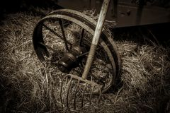 Hay Pitchfork and Old Wheel in Barn Stock Photography