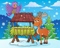 Hay rack with reindeer and bird Royalty Free Stock Photos